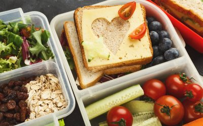 School lunch boxes for child. Healthy snacks, fruits and vegetables for dinner meals out of home. Eating right and food storage concept, closeup